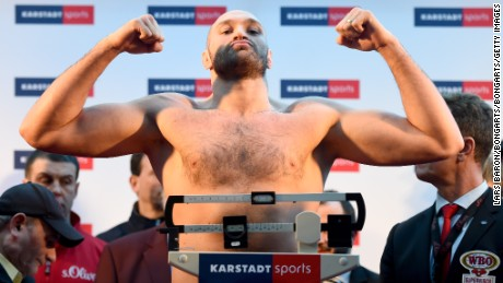 ESSEN, GERMANY - NOVEMBER 27: Tyson Fury of UK poses after the weigh in at Karstadt Sport on November 27, 2015 in Essen, Germany.  (Photo by Lars Baron/Bongarts/Getty Images)