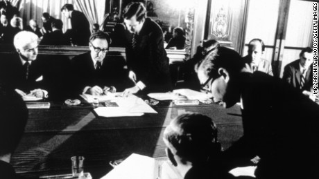 American Secretary of State Henry Kissinger and Vietnamese politician Le Duc Tho signing the Paris peace agreement which ended the Vietnam War.