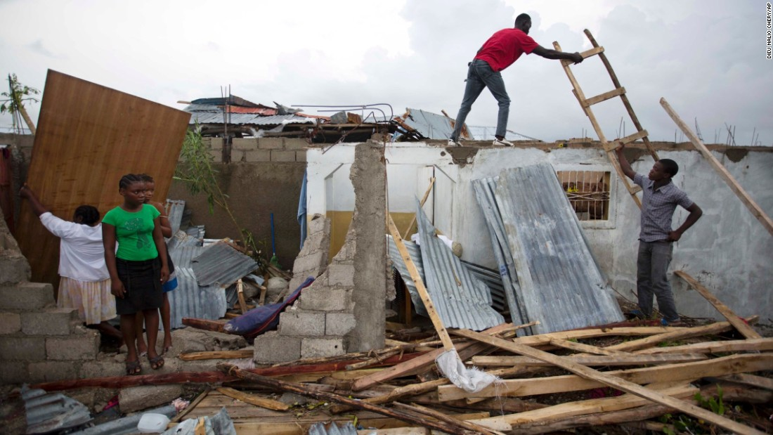 "Residents repair their homes in Les Cayes, Haiti, on October 6. <a href=""http://www.cnn.com/2016/10/04/americas/hurricane-matthew/index.html"" target=""_blank"">The damage from Hurricane Matthew</a> was especially brutal in southern Haiti, where sustained winds of 130 mph punished the country."