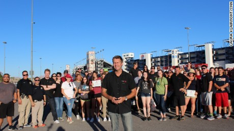 CNN Hero and former racecar driver Jeff Payne started Driver's Edge to educate young drivers and their parents about road safety. Participants join him for a group photo.