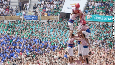 "TARRAGONA, SPAIN - OCTOBER 02: Members of Tarragona's team make the tower during the Spain's traditional human towers competition ""Concurs de Castells"" at Tarraco Arena in Tarragona, Spain on October 02, 2016.  (Photo by Albert Llop/Anadolu Agency/Getty Images)"