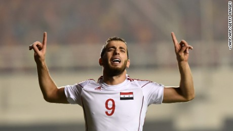 Mahmoud Al-Mawas celebrates his winning goal against China in World Cup qualifying.