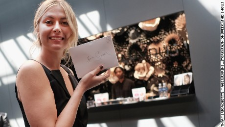 Sharapova promotes her new candy 'Sugarpova' at New York Fashion Week in  September.