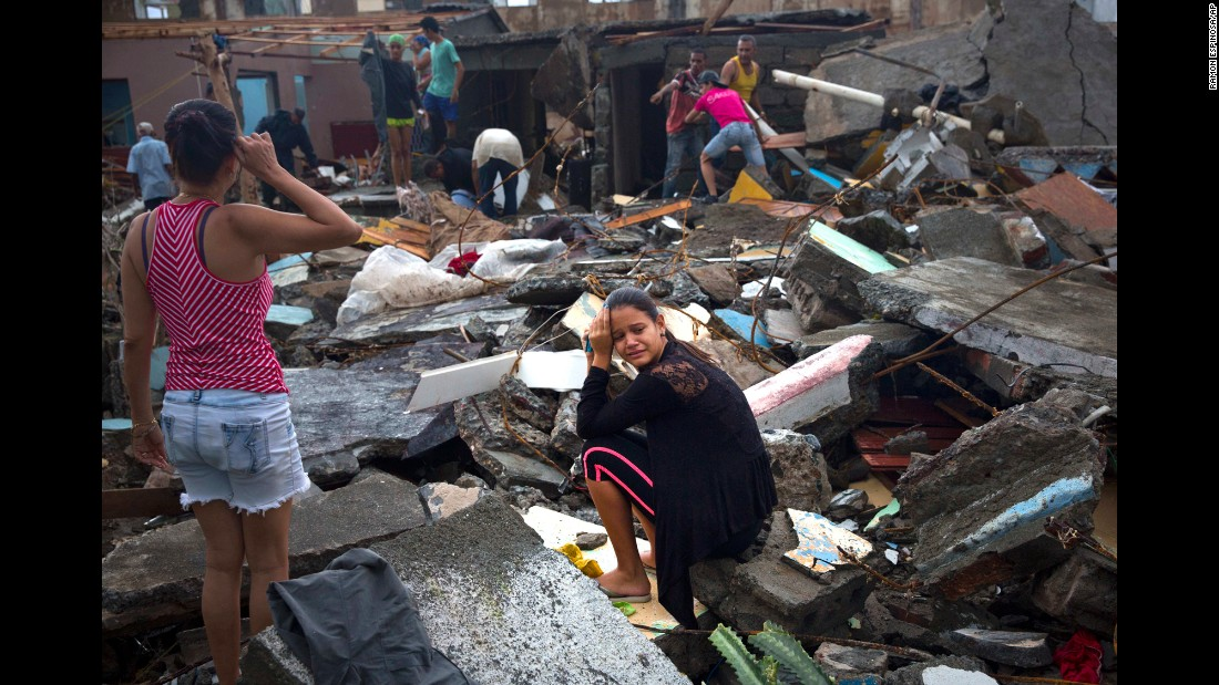 """A woman cries amid the rubble of her home in Baracoa, Cuba, on Wednesday, October 5. <a href=""""http://www.cnn.com/2016/10/03/world/gallery/hurricane-matthew/index.html"""" target=""""_blank"""">Hurricane Matthew</a> rolled across the sparsely populated tip of Cuba, destroying dozens of homes in the country's easternmost city."""