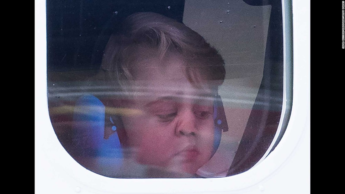 """Britain's Prince George looks out the window of a seaplane as he and his family leave Victoria, British Columbia, on Saturday, October 1. <a href=""""http://www.cnn.com/2016/09/24/world/gallery/royals-visit-canada-sept-2016/index.html"""" target=""""_blank"""">See more photos of the royals' eight-day trip to Canada </a>"""