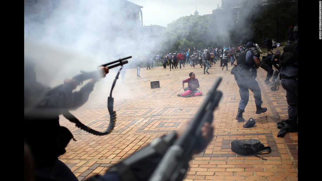 """Police <a href=""""http://www.cnn.com/2016/10/04/africa/south-africa-student-protests/"""" target=""""_blank"""">fire tear gas, stun grenades and rubber bullets </a>at people who were protesting at Johannesburg's Wits University on Tuesday, October 4. The protesters were voicing frustration over an increase in South Africa's university fees."""