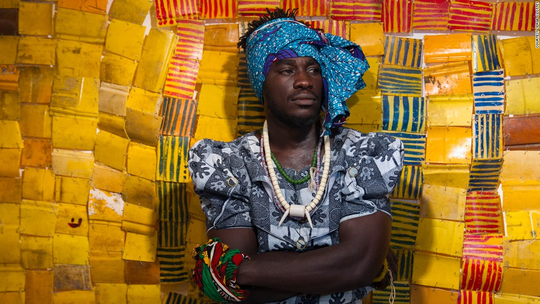 Ghanaian born Clottey often dresses up in women's clothes in public street performances with his 70 strong collective who take part in his public art performances.