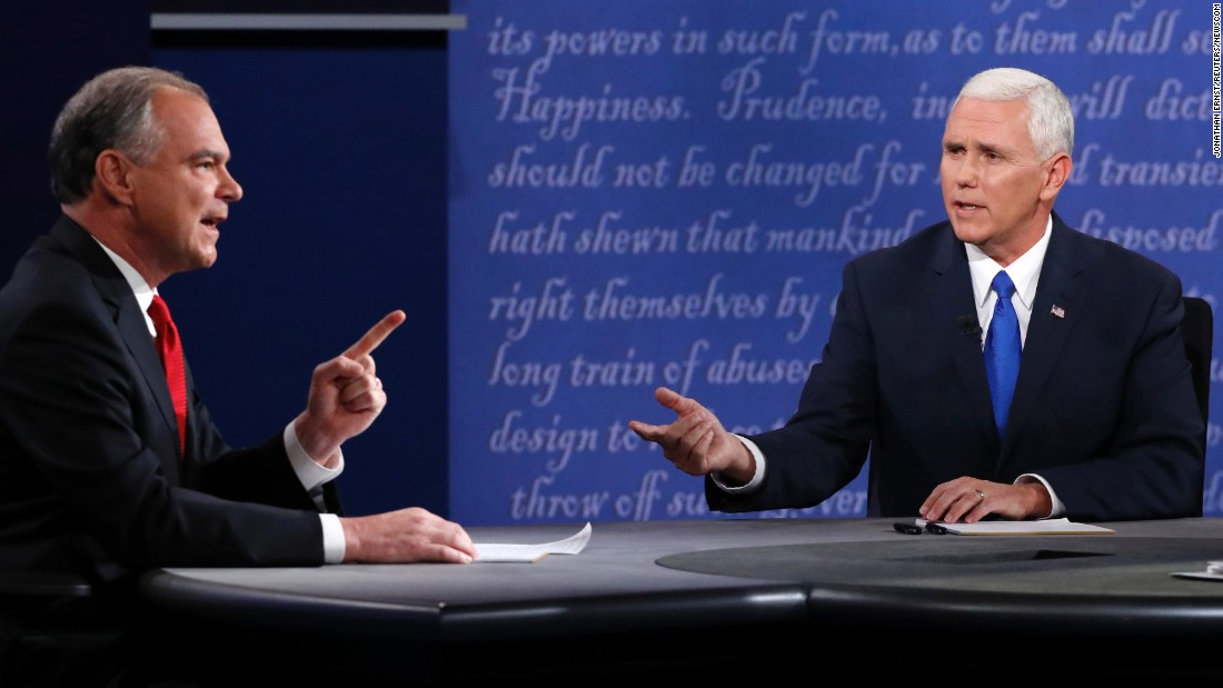 """U.S. Sen. Tim Kaine, left, discusses an issue with Indiana Gov. Mike Pence during <a href=""""http://www.cnn.com/2016/10/04/politics/gallery/vice-presidential-debate/index.html"""" target=""""_blank"""">the vice presidential debate</a> on Tuesday, October 4. Kaine is the running mate to Democratic nominee Hillary Clinton. Pence is on the ticket with Republican nominee Donald Trump. <a href=""""http://www.cnn.com/2016/10/05/opinions/pence-kaine-debate-reaction-roundup/"""" target=""""_blank"""">Opinions: Who won the debate?</a>"""