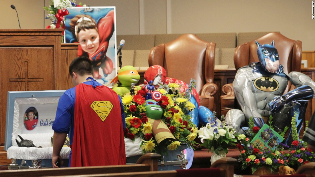 """Dale Hall, dressed as Superman, stands near the casket of his brother Jacob during his funeral in Townville, South Carolina, on Wednesday, October 5. Jacob, 6, was fatally wounded during a shooting last week at an elementary school playground. He loved superheroes, so <a href=""""http://www.cnn.com/2016/10/05/us/jacob-hall-superhero-funeral-townville-south-carolina-school-shooting/"""" target=""""_blank"""">his funeral</a> carried that theme. Funeral attendees were encouraged to wear superhero outfits, and Jacob himself was dressed as Batman."""