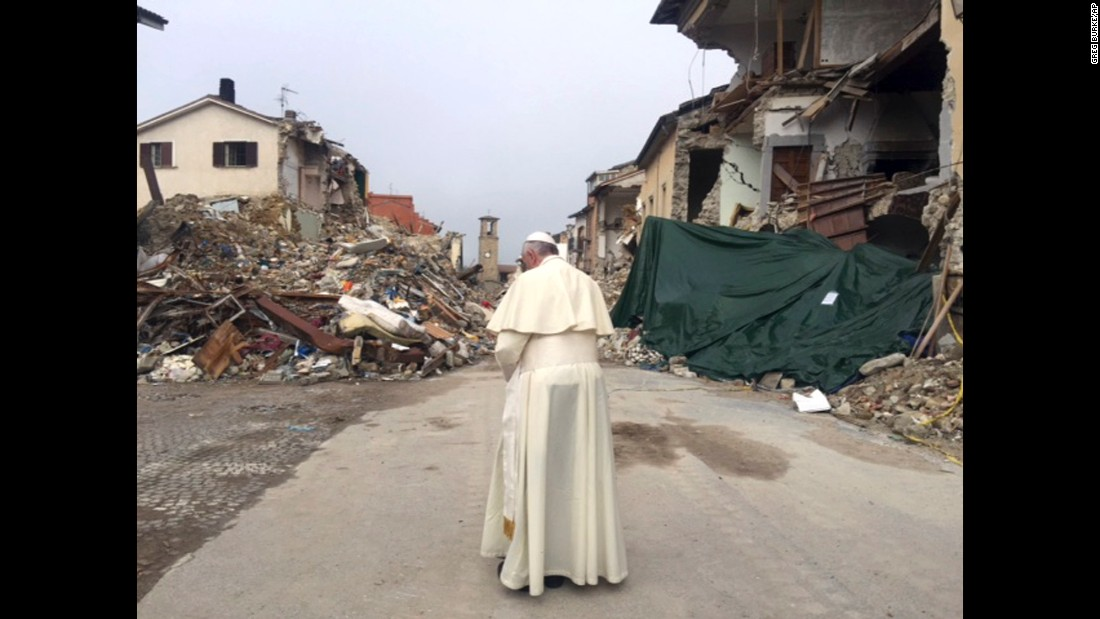 """Pope Frances prays in Amatrice, Italy, on Tuesday, October 4. The town was <a href=""""http://www.cnn.com/2016/08/24/europe/italy-earthquake-towns/"""" target=""""_blank"""">devastated by an earthquake</a> in August."""