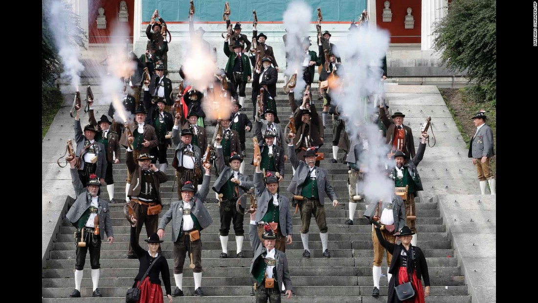 """Men and women in traditional Bavarian costumes fire muzzleloaders Monday, October 3, on the last day of the Oktoberfest beer festival in Munich, Germany. <a href=""""http://www.cnn.com/2016/09/21/world/gallery/tbt-oktoberfest/index.html"""" target=""""_blank"""">#tbt: Lighthearted moments from old Oktoberfests</a>"""