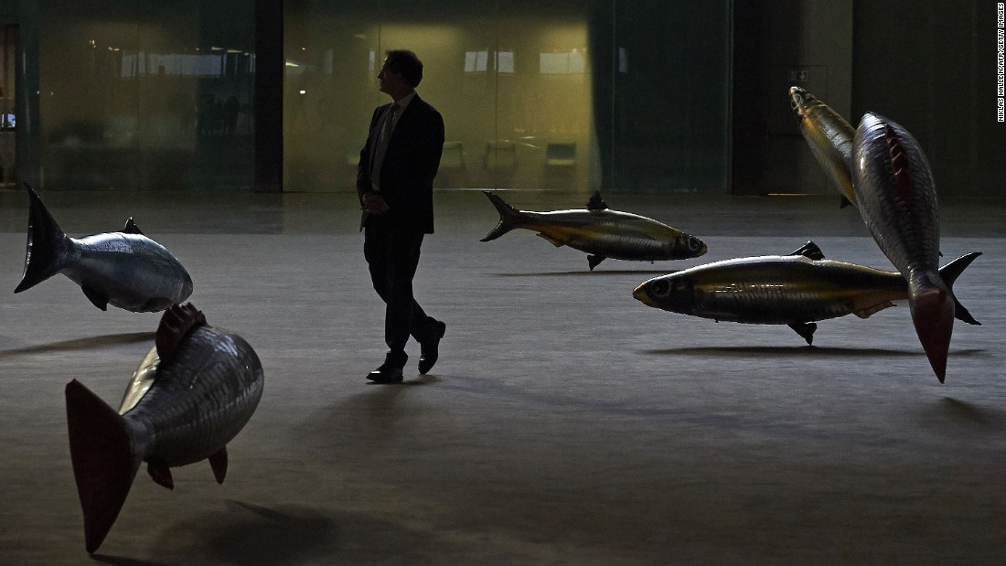 """A man views part of Philippe Parreno's """"Anywhen"""" at the Tate Modern art gallery in London on Monday, October 3. <a href=""""http://www.cnn.com/2016/09/29/world/gallery/week-in-photos-0930/index.html"""" target=""""_blank"""">See last week in 35 photos</a>"""
