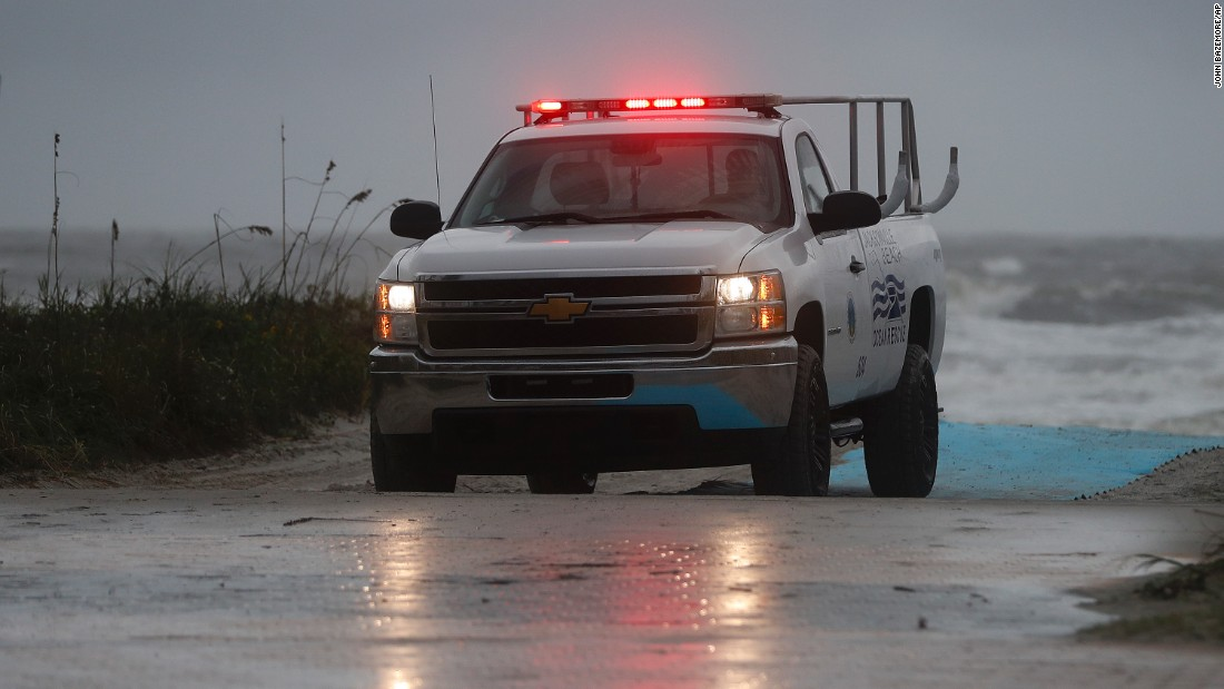 A lifeguard patrols the beach in Jacksonville, Florida, ahead of the storm on October 6.