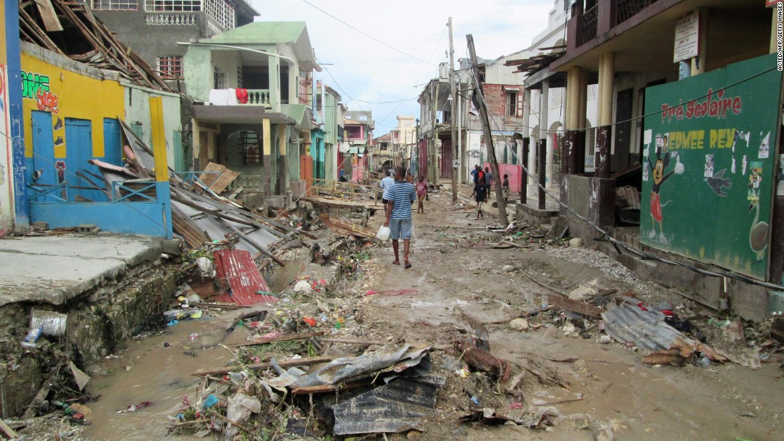 A man walks through the devastated town of Jeremie in west Haiti.