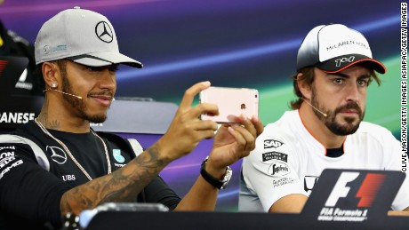 Lewis Hamilton plays with his phone in a press conference ahead of the Japan Grand Prix in Suzuka.