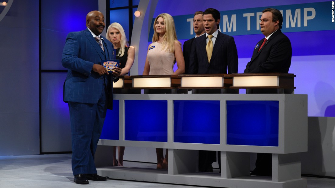 "Kenan Thompson plays ""Family Feud"" host Steve Harvey in a politically themed ""Saturday Night Live"" sketch on Saturday, October 1. Playing on the fictitious Team Trump, from left: Kate McKinnon as Donald Trump campaign manager Kellyanne Conway, Margot Robbie as Ivanka Trump, Alex Moffat as Eric Trump, Mikey Day as Donald Trump Jr. and Bobby Moynihan as New Jersey Gov. Chris Christie."