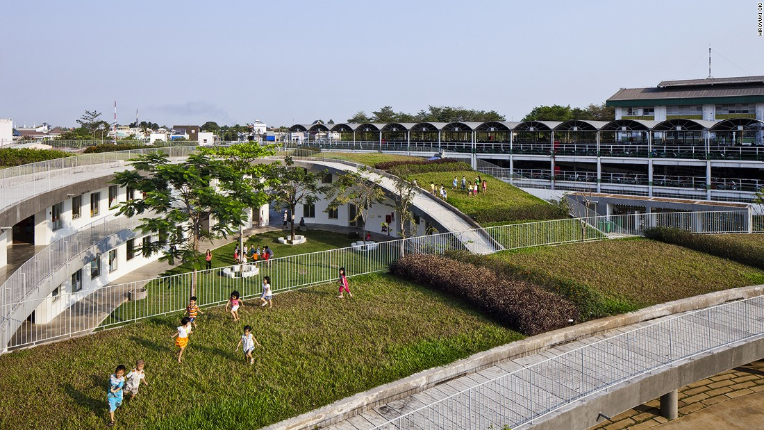 Built for 500 children of the neighboring factory's workers, the building has a large green roof which becomes an extensive open playground.