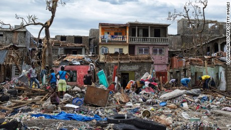 People stand in their destroyed town of Jeremie, Haiti on Thursday October 6.