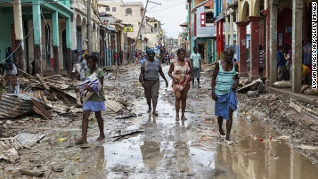 People walk through the devastated town of Jeremie on Thursday.