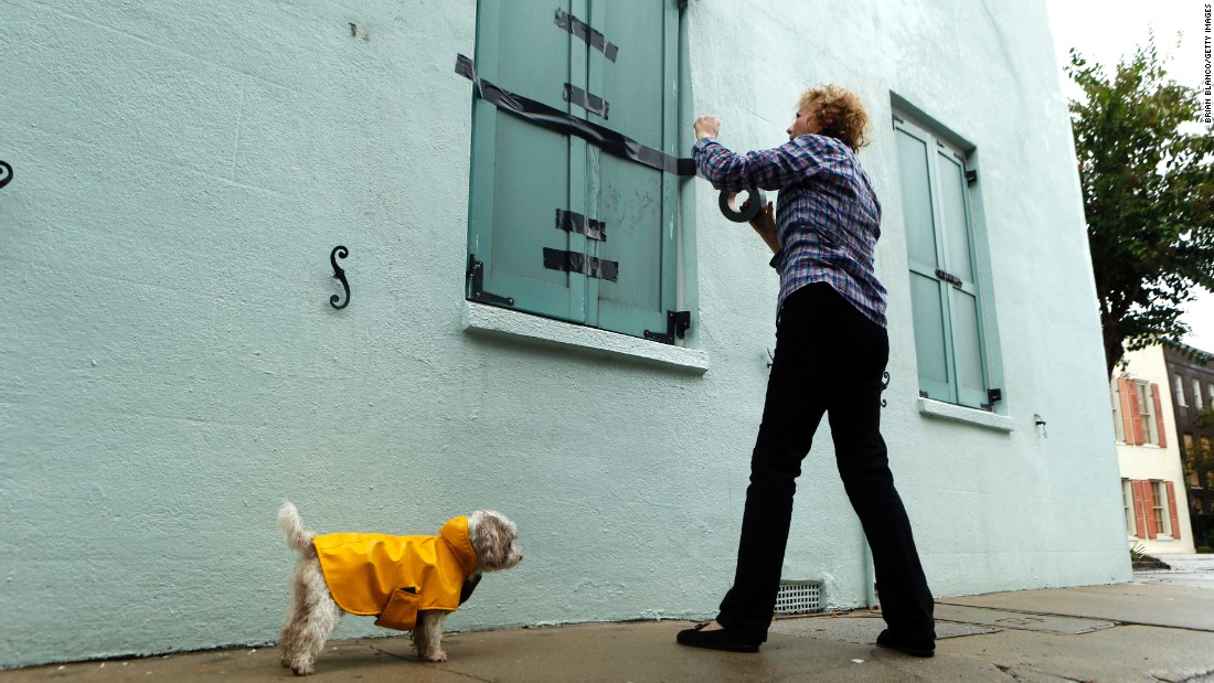 Barbara Hearst tapes her storm shutters as Hurricane Matthew nears Charleston, South Carolina, on October 7.