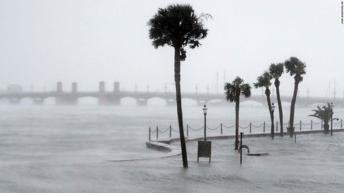 Water flows over a seawall and fills the streets of St. Augustine, Florida, on October 7.