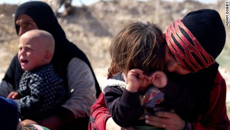 Displaced people arrive in Daqouq. The children are exhausted from the journey; the parents wary of what comes next.