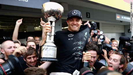 Nico Rosberg celebrates his victory at Suzuka with his Mercedes team which has sealed the Constructors' crown.