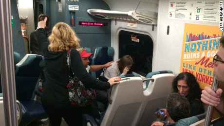 Passengers on board the service react to the train's derailment.