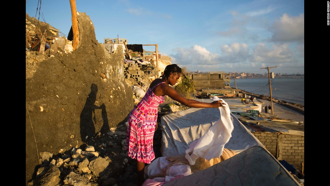 Andrenne Joseph dries her clothes near the remains of her house in Jeremie on October 8.