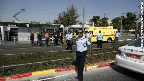 Israeli security forces and policemen gather at the scene of the attack.