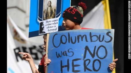 Henry Killscrow and his little brother Walter show their support during the Four Directions All Nations Rally at the State Capitol October 08. A large group of American Indians and allies gathered in protest of Columbus Day and the parade that was held earlier in Downtown Denver.