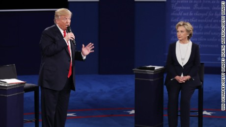 ST LOUIS, MO - OCTOBER 09:  Republican presidential nominee Donald Trump (L) speaks as Democratic presidential nominee former Secretary of State Hillary Clinton looks on during the town hall debate at Washington University on October 9, 2016 in St Louis, Missouri. This is the second of three presidential debates scheduled prior to the November 8th election.  (Photo by Win McNamee/Getty Images)