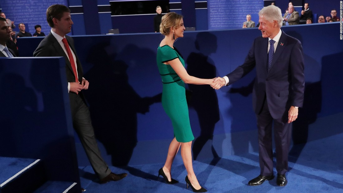 Clinton's husband, former U.S. President Bill Clinton, shakes hands with Ivanka Trump before the debate.