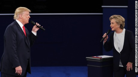 Democratic presidential nominee former Secretary of State Hillary Clinton and Republican presidential nominee Donald Trump speak during the town hall debate at Washington University on October 9, 2016, in St. Louis.