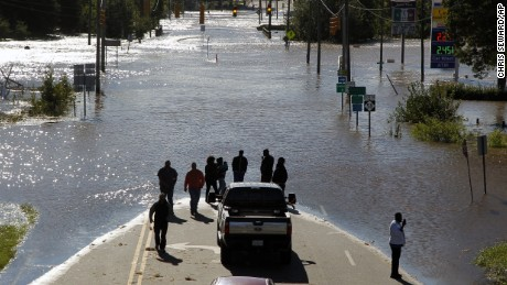 An unbelievable sight: People stop and take pictures of the flooded Highway 58 in Nashville, N.C