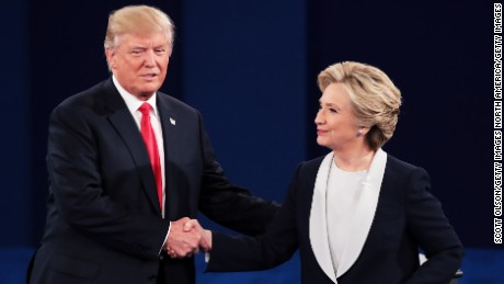 ST LOUIS, MO - OCTOBER 09:  Republican presidential nominee Donald Trump (L) shakes hands with Democratic presidential nominee former Secretary of State Hillary Clinton during the town hall debate at Washington University on October 9, 2016 in St Louis, Missouri. This is the second of three presidential debates scheduled prior to the November 8th election.  (Photo by Scott Olson/Getty Images)