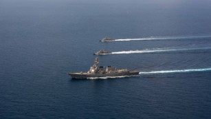 The USS Mason conducts formation exercises with Navy patrol crafts in September.