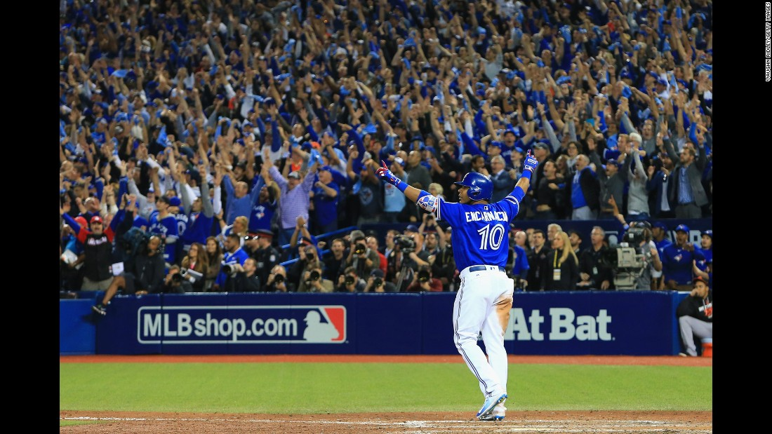 Edwin Encarnacion celebrates after he hit an 11th-inning home run to win the American League wild-card game for Toronto on Tuesday, October 4. The Blue Jays later swept the Texas Rangers to advance to the American League Championship Series.