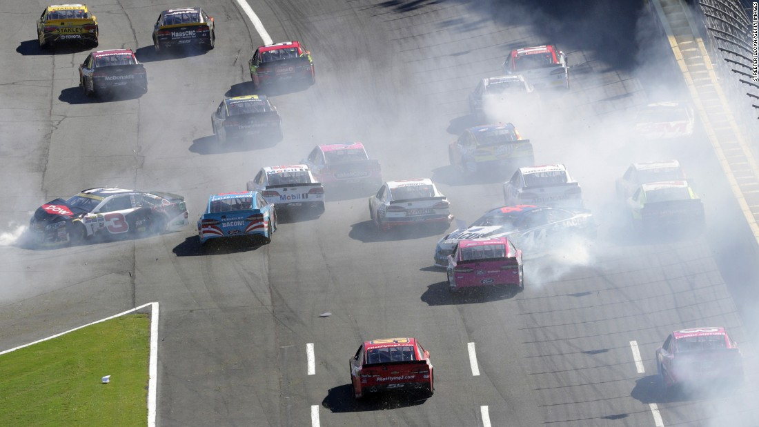 Cars wreck on the front stretch of Charlotte Motor Speedway during a NASCAR Sprint Cup race on Sunday, October 9.