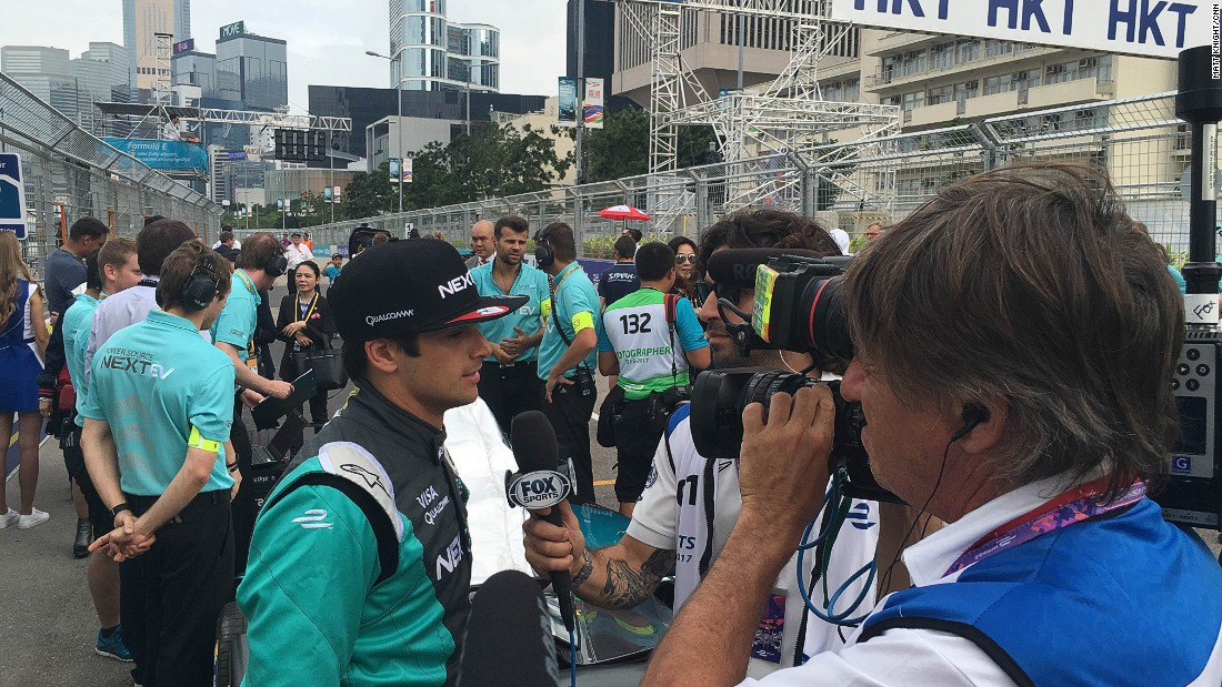 Polesitter Nelson Piquet Jr talking to the media on the grid ahead of Sunday's race.