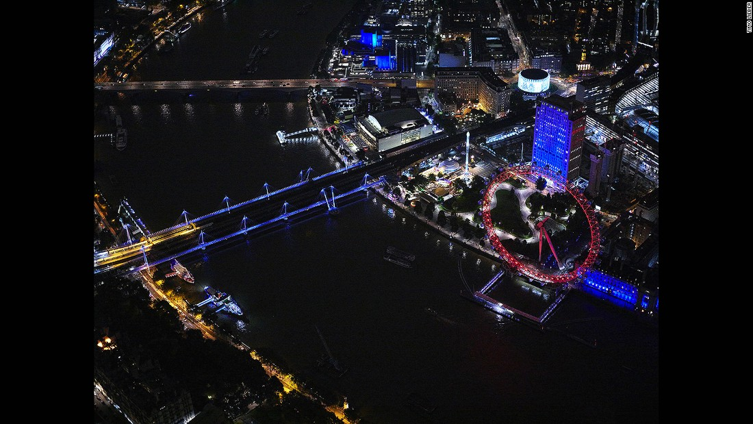 He achieves these remarkable images by hanging out of a helicopter as it zooms over the UK capital. Here we see the London Eye and Hungerford and Golden Jubilee Bridges.