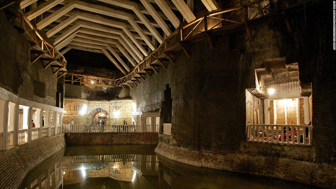 """In southern Poland, Lake Wessel lies inky and unmoving in the deep. Filling the bottom of an old salt mine, it's just one component of the UNESCO World Heritage Site which has been a functioning mine since the 13th century. Featuring supreme carpentry, centuries-old brickwork and ornate chandeliers in cavernous dining rooms, this fantastical setting is a favorite for the Polish film industry, with portions of cult movie """"<a href=""""http://www.imdb.com/title/tt0088083/"""" target=""""_blank"""">Seksmisja</a>"""" (""""Sexmission"""") shot on the site."""