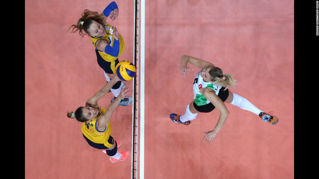 Bursa volleyball player Yaren Hatipoglu, right, competes against Proton Saratov during an international tournament in Bursa, Turkey, on Sunday, October 9.