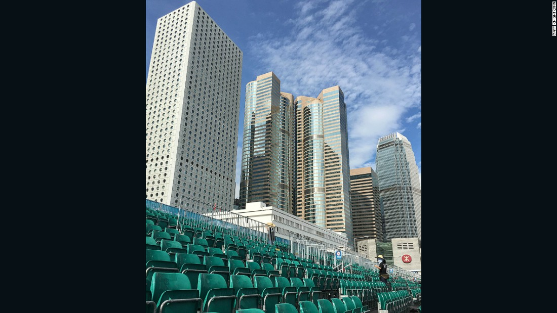 Cleaners prepare the grandstands on Sunday morning ahead of the Hong Kong race.
