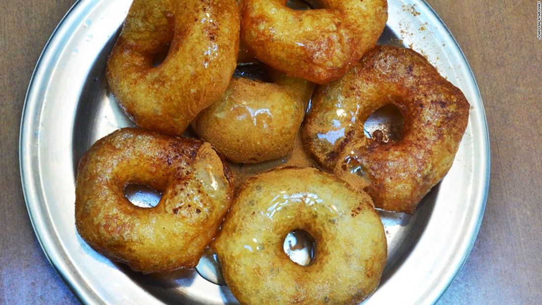Loukoumades, fried dough balls in honey and cinnamon, are as unique to Greece as the Parthenon. Straight from the pan, they're delicate, fluffy and fragrant.<br />