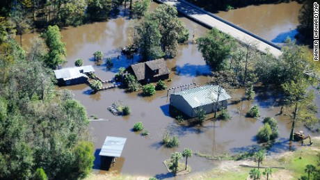 A home sits in flood waters in Nichols, South Carolina, Monday, October 10. Nearly 1 million homes and businesses still did not have power Monday morning in North Carolina and South Carolina after Hurricane Matthew.