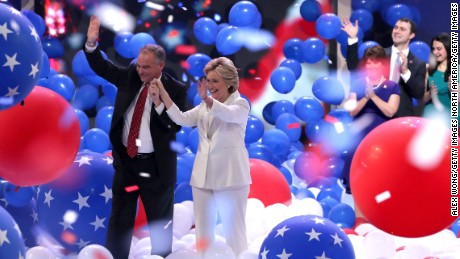 PHILADELPHIA, PA - JULY 28:  Democratic presidential candidate Hillary Clinton and US Vice President nominee Tim Kaine acknowledge the crowd at the end of the fourth day of the Democratic National Convention at the Wells Fargo Center, July 28, 2016 in Philadelphia, Pennsylvania. Democratic presidential candidate Hillary Clinton received the number of votes needed to secure the party's nomination. An estimated 50,000 people are expected in Philadelphia, including hundreds of protesters and members of the media. The four-day Democratic National Convention kicked off July 25.  (Photo by Alex Wong/Getty Images)