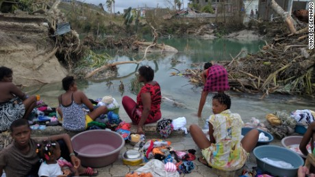 Haitian women and children gather in Port Salut to wash clothes after the devastating effects of Hurricane Matthew.