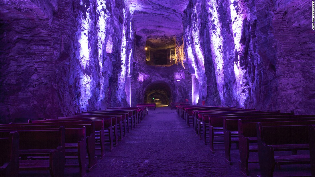 """Originally carved inside an active salt mine, the Salt Cathedral of Zipaquira sits 660 feet underground in Cundinamarca, Colombia. In 1950, work began on a space for workers to pray before starting their shift, with the site inaugurated in 1954, dedicated to Our Lady of Rosary, patron saint of miners (of course). A popular tourist site 28 miles north of Bogota, in 2014 the Gallery Nueveochenta took over the space, using it to house contemporary art by the likes of <a href=""""https://www.flickr.com/photos/aldochaparro/14476001276/in/photostream/"""" target=""""_blank"""">Aldo Chaparro Winder</a>. (Picture via <a href=""""https://creativecommons.org/licenses/by/2.0/."""" target=""""_blank"""">Creative Commons 2.0</a>)"""