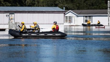 Rescue teams maneuver through floodwaters Monday in Lumberton, North Carolina.